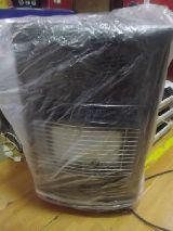 Estufa de butano protegida en una funda de plástico